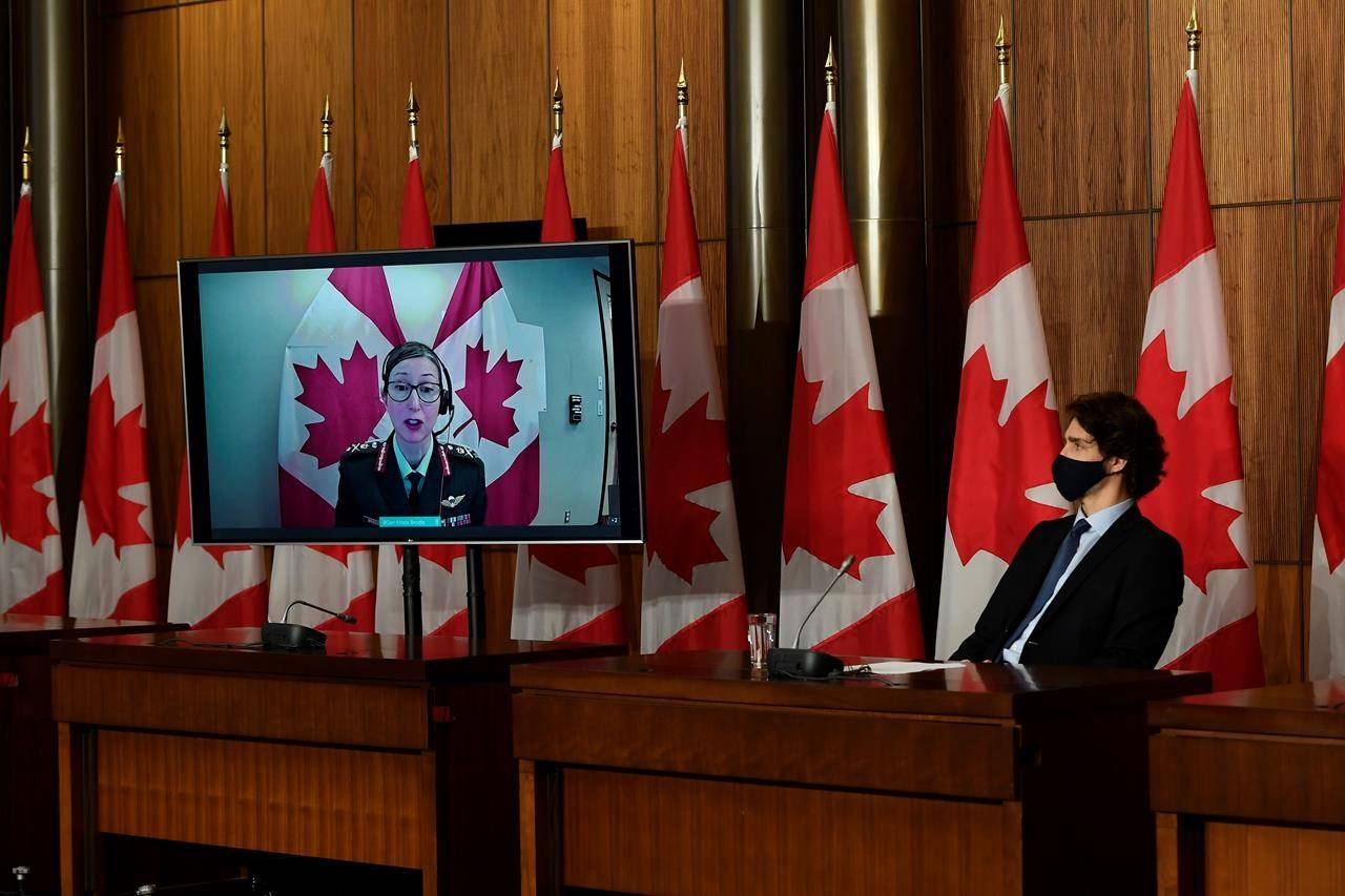 Justin Trudeau listens as Brig.-Gen. Krista Brodie, Vice President of Vaccine Logistics and Operations at the Public Health Agency of Canada, is seen via videoconference on Friday, June 4, 2021. THE CANADIAN PRESS/Justin Tang