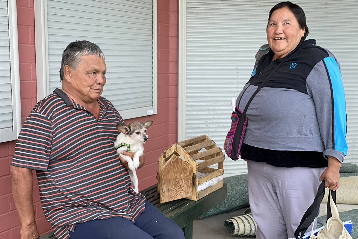 Ulkatcho First Nation members Steve Cahoose and Margaret Charleyboy evacuated from their home out west to Williams Lake with their dog scruffy. The couple plan to stay in Williams Lake with relatives. (Angie Mindus photo - Williams Lake Tribune)