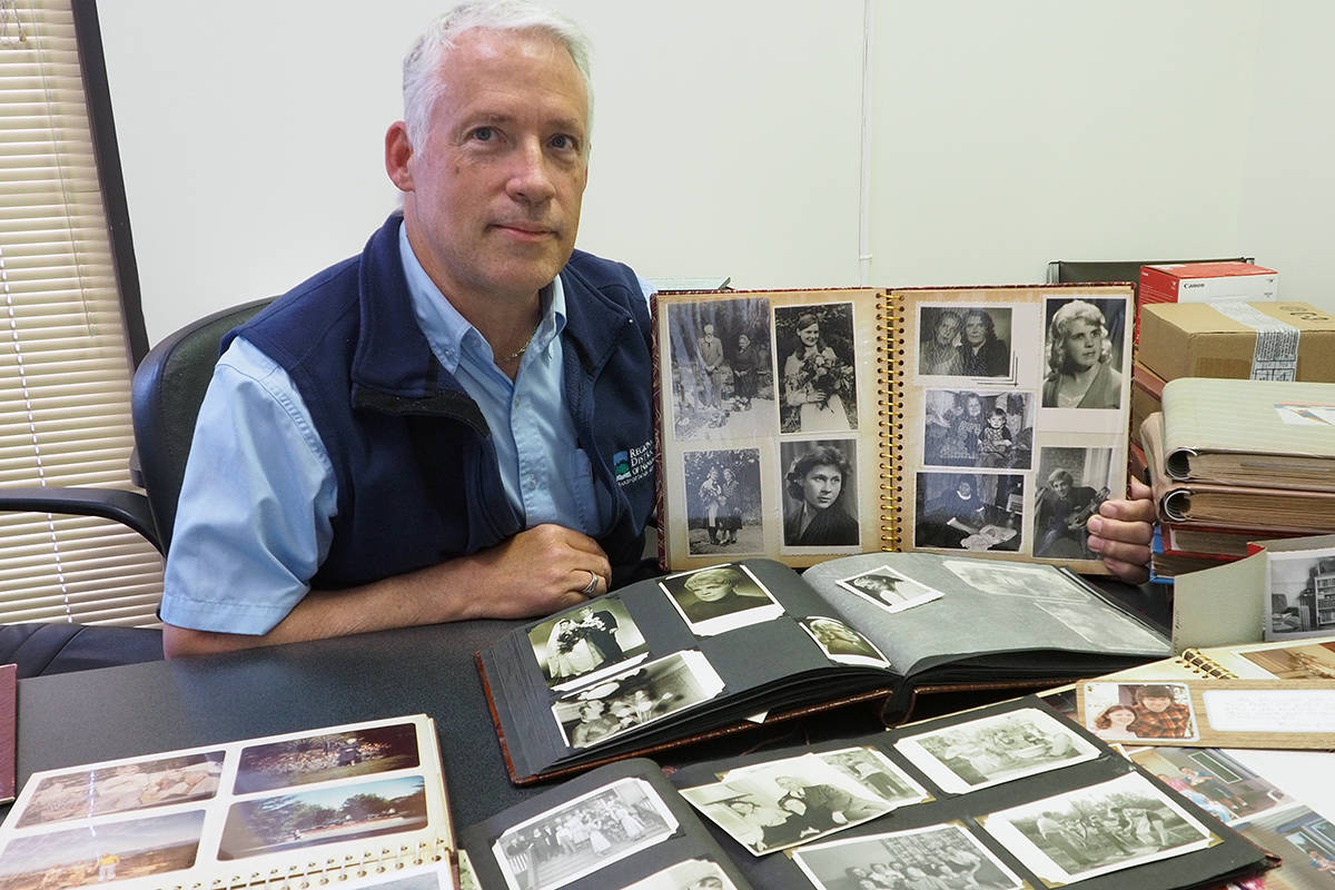 Nanaimo's Michael Suiker is trying to track down family members who might like 10 photo albums he salvaged at an estate sale in 2018. (Chris Bush/News Bulletin)