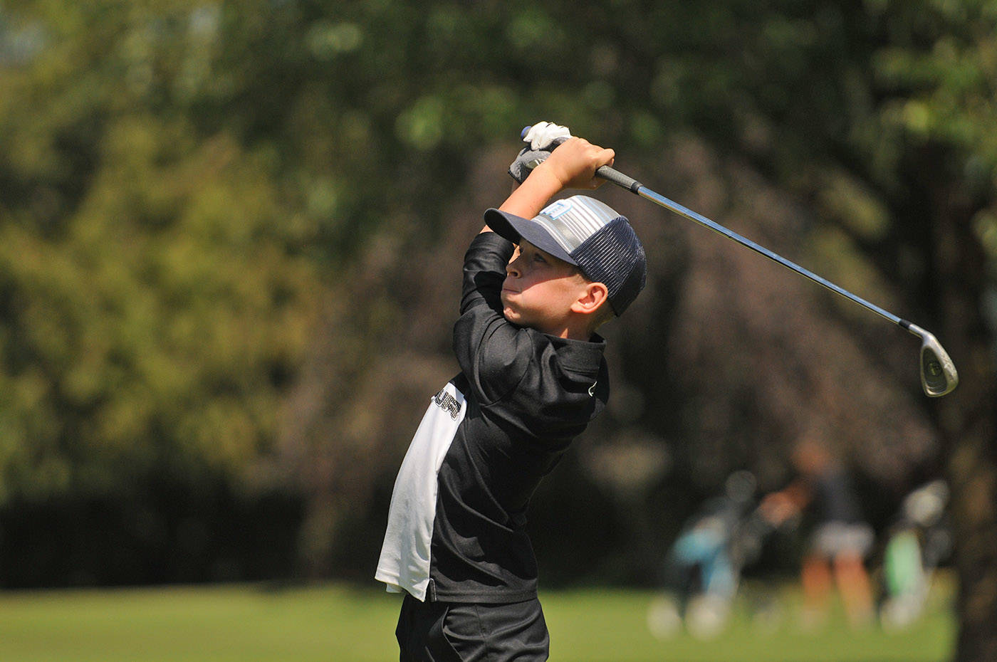 Chilliwack's Owen Hopfner tees off from the fourth hole at Chilliwack Golf Club during the final round of the 2021 Optimist Fred Wellsby Junior Divot golf tournament on Thursday, July 15, 2021. (Jenna Hauck/ Chilliwack Progress)