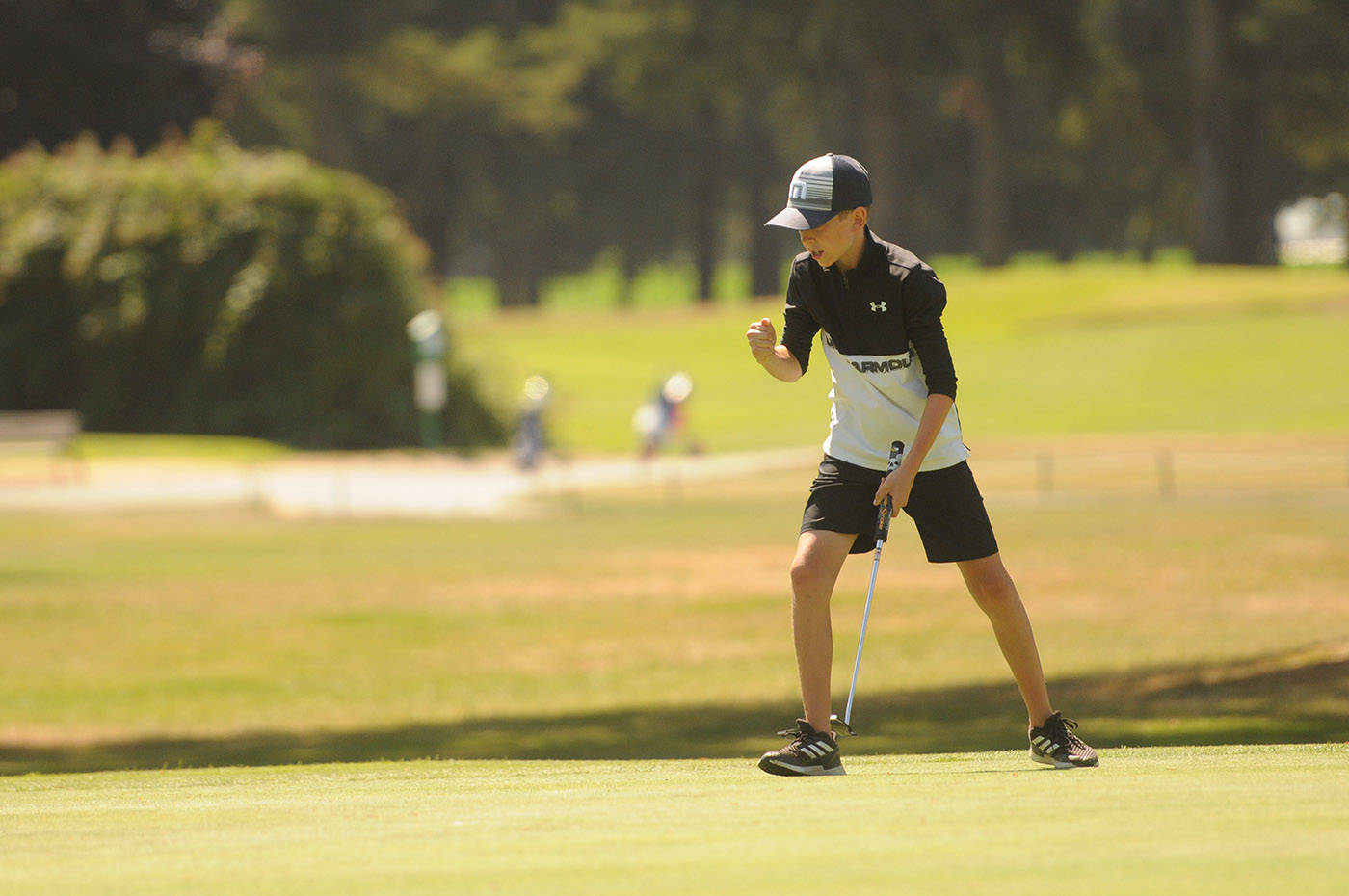 Chilliwack's Owen Hopfner celebrates a successful putt on the third green at Chilliwack Golf Club during the final round of the 2021 Optimist Fred Wellsby Junior Divot golf tournament on Thursday, July 15, 2021. (Jenna Hauck/ Chilliwack Progress)