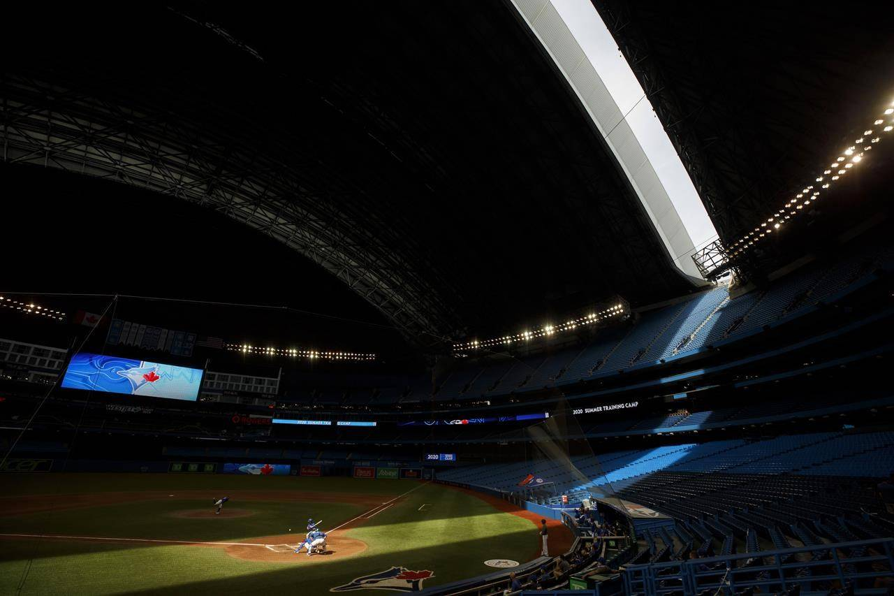 The Toronto Blue Jays participate in a batting practice at Summer Training Camp in Toronto, Sunday, July 19, 2020. Ontario's sports minister has asked the federal government to allow the Toronto Blue Jays to play in Canada. THE CANADIAN PRESS/Cole Burston
