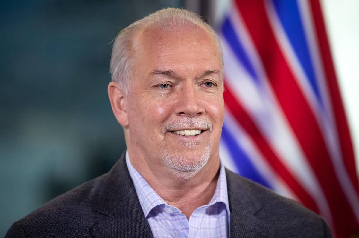 B.C. In Vancouver, Premier John Horgan smiles during a news conference on Sunday, October 25, 2020. THE CANADIAN PRESS/Darryl Dyck