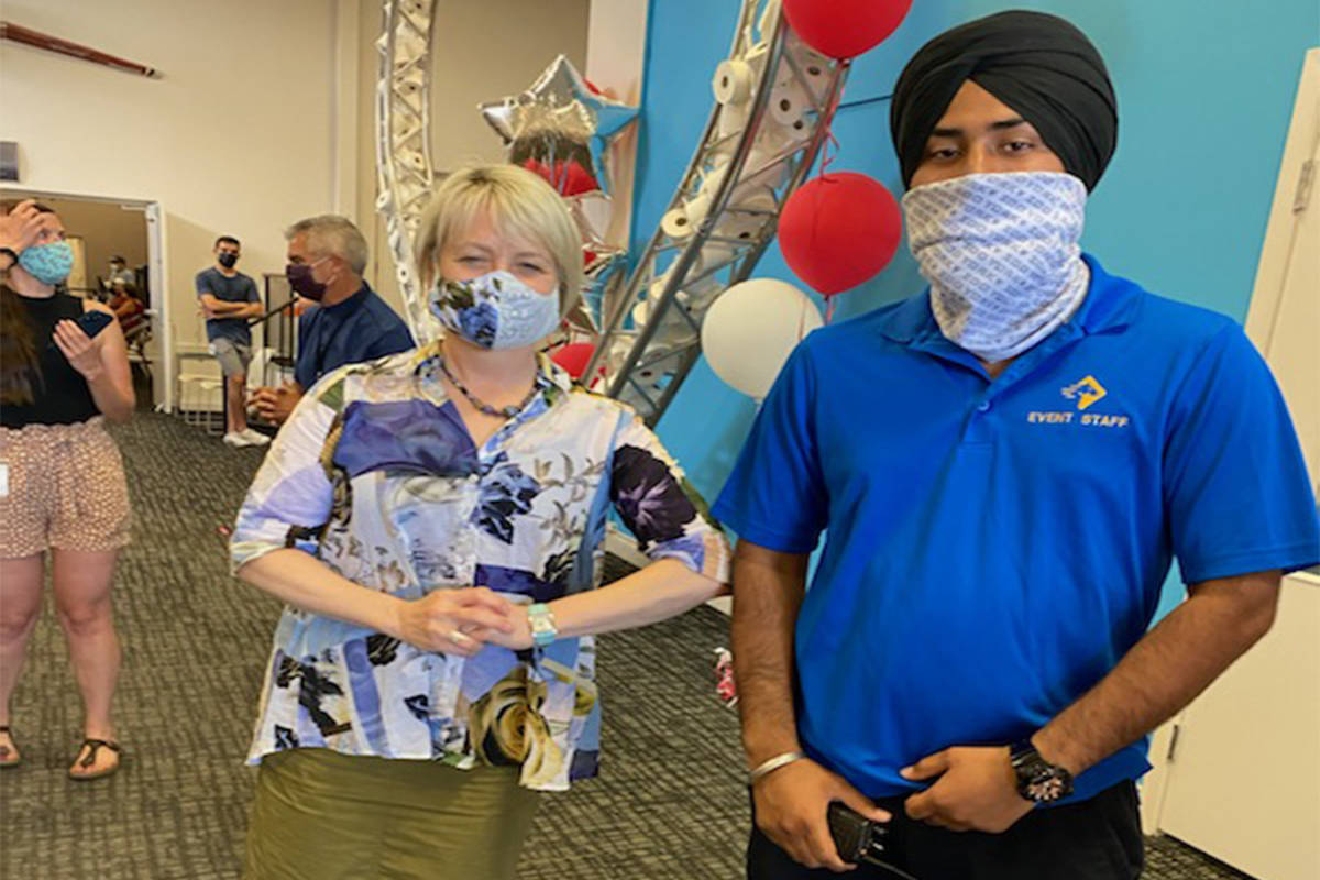 Dr. Bonnie Henry is pictured with Anmol, who was attacked in a racist tirade earlier this week. Henry visited Trinity Baptist Church, a vaccination site last month. (Paladin Security/Twitter)