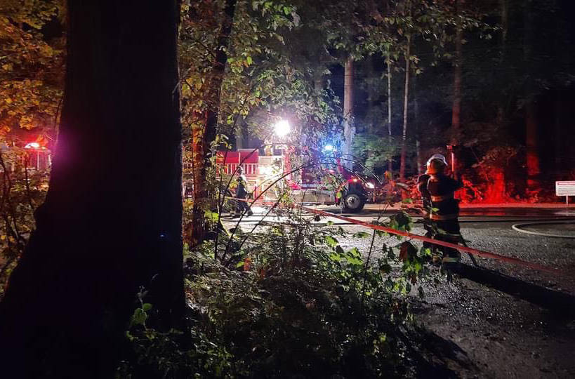 Cultus Lake Fire Department firefighters on the scene of a trailer fire at Cultus Lake's Sunnyside campground in the early hours of Wednesday, July 14. (Facebook photo)