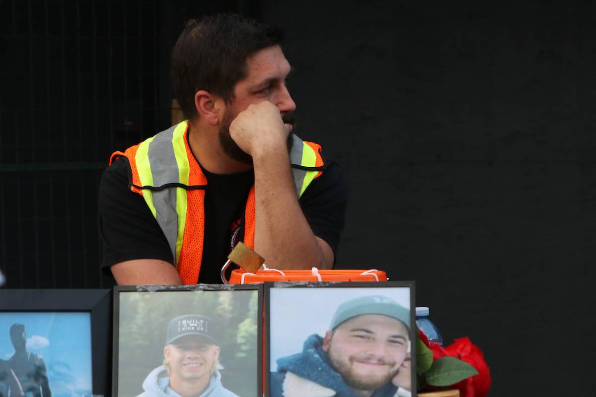A member of the North Okanagan Labour Council pauses during the vigil. (Aaron Hemens/Capital News)