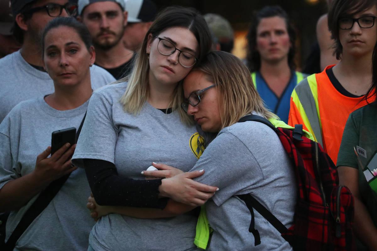 Attendants comfort one another. (Aaron Hemens/Capital News)