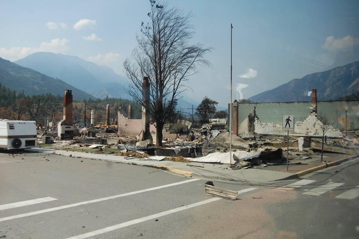 Chimneys in a burnt-out lot beside the post office on Main Street, Lytton. (Photo credit: Barbara Roden)
