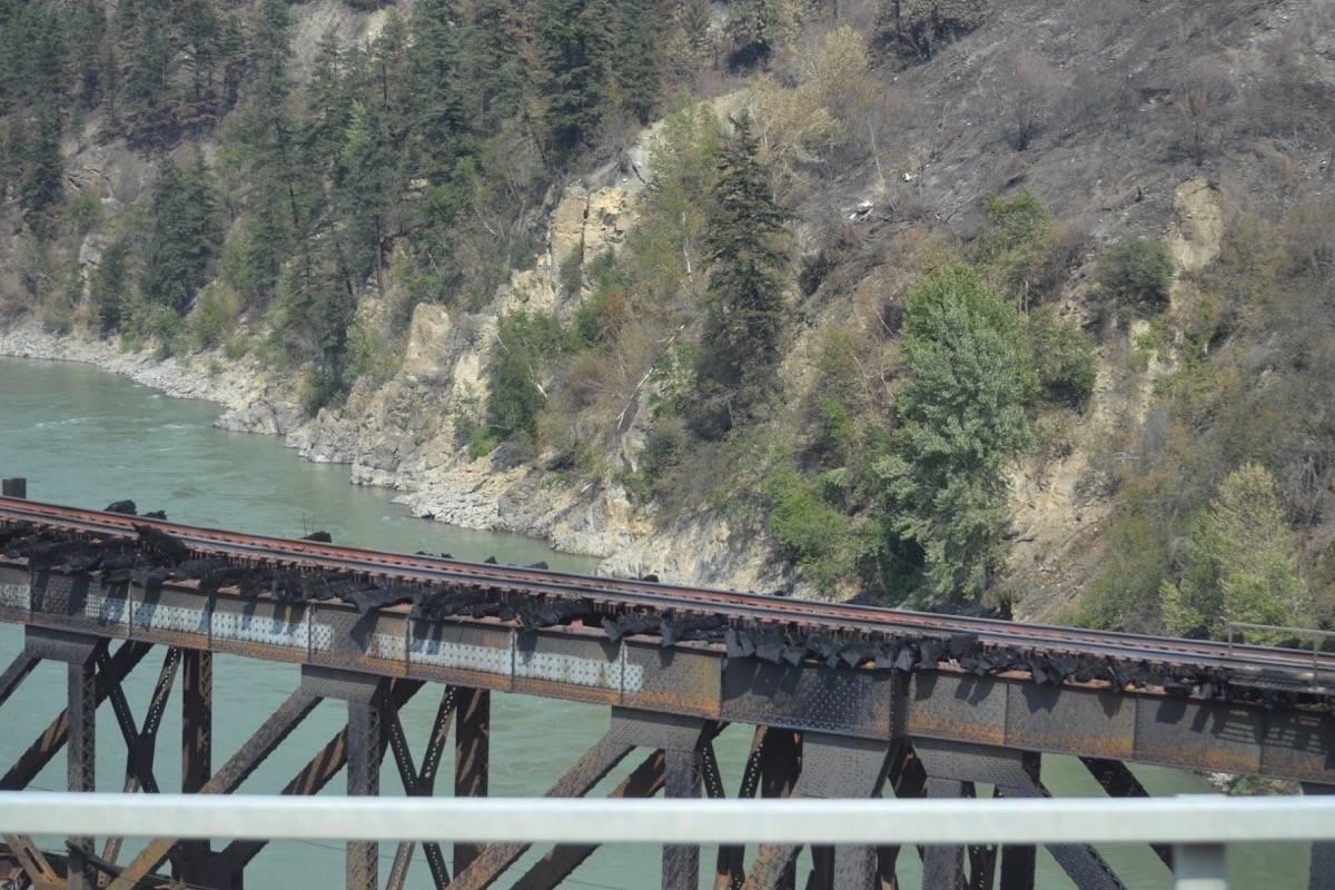 CN rail bridge over the Thompson River, July 9, 2021, showing burned rail ties. (Photo credit: Barbara Roden)