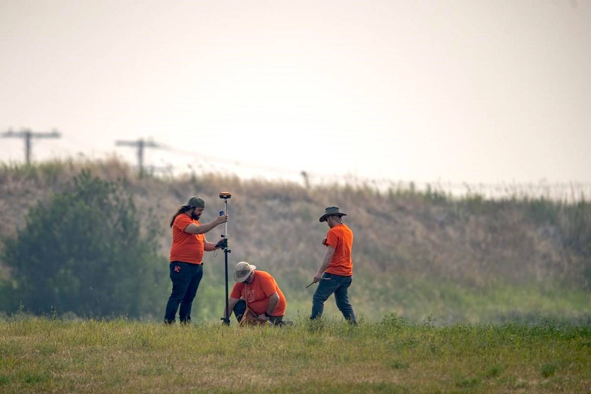 SNC Lavalin engineers use equipment to conduct a search of the grounds at the site of a former Residential School in Delmas, Sask., Saturday, July 17, 2021. THE CANADIAN PRESS/Liam Richards