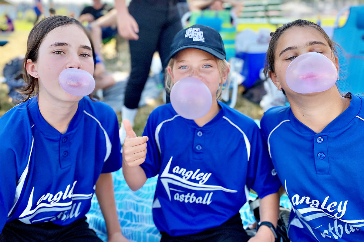 Stellar Jays players Maya Bettler (L), Maelle Snyder and Livia Maione (R) demonstrated proper chewing form at the U12C Stellar Region 3 provincial championships on July 11 at the Albion Sports Complex in Maple Ridge (Special to Langley Advance Times)