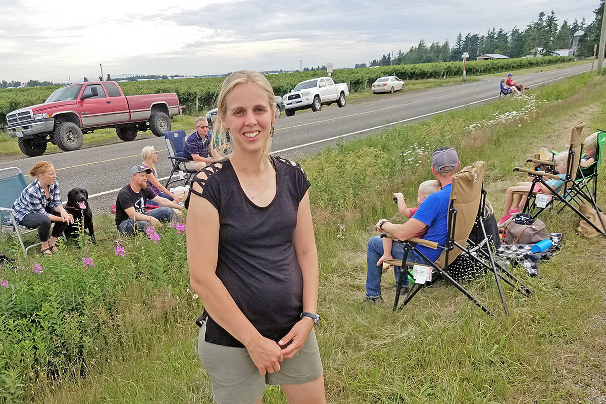 Aldergrove resident Georgene VanDelft, seen here meeting U.S. relatives along the border on Tuesday, June 23, 2020, isn't optimistic about the Prime Minister's suggestion the U.S. – Canada border could be reopened soon. (Dan Ferguson/Langley Advance Times)