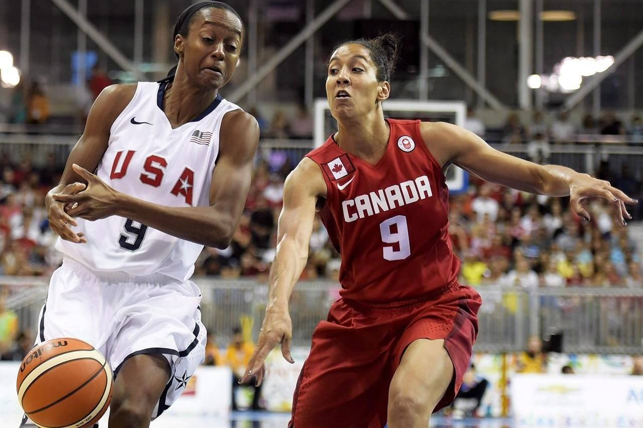 Canada forward Miranda Ayim battles for the ball against United States guard Shatori Walker (9) during first half gold medal action at the Pan American Games in Toronto on Monday, July 20, 2015. Women's basketball player Miranda Ayim and men's rugby sevens player Nathan Hirayama have been named Canada's flag-bearers for the opening ceremony of the Tokyo Olympics. THE CANADIAN PRESS/Nathan Denette