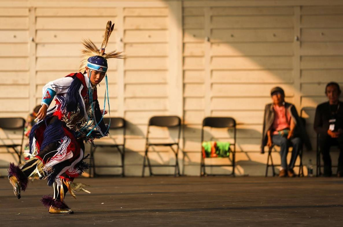 An Indigenous dancer performs in the Elbow River Camp at the Calgary Stampede in Calgary, Alta., Wednesday, July 14, 2021. THE CANADIAN PRESS/Jeff McIntosh