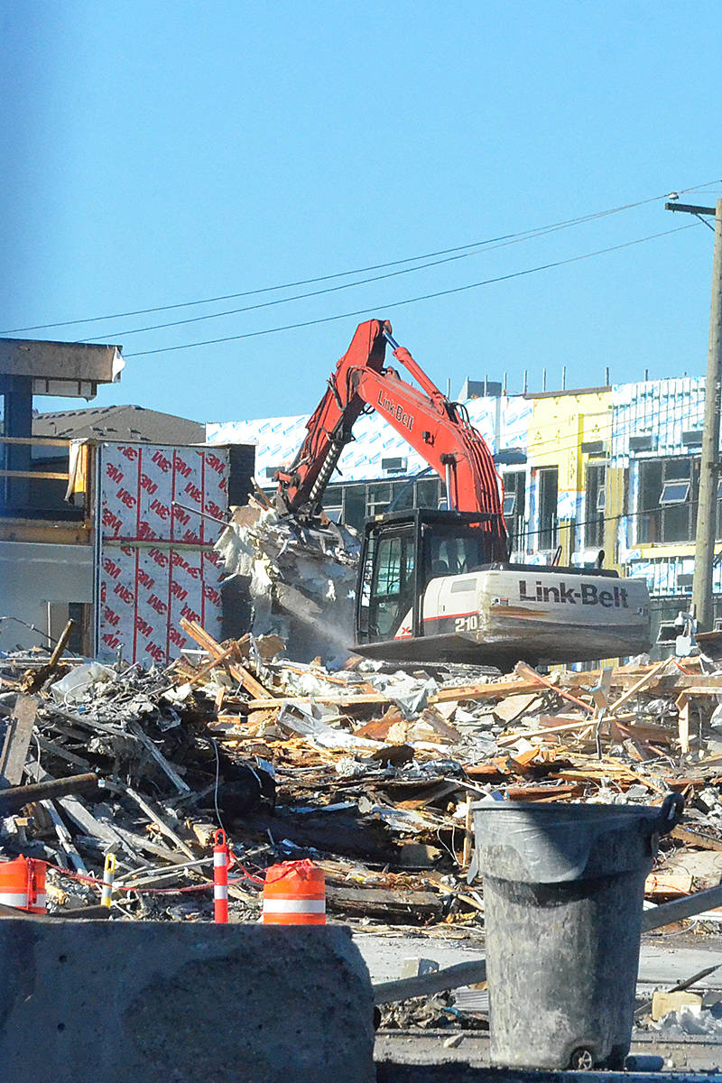 Heavy equipment is tearing down the remaining portion of the fire-damaged condo complex at 208th Street and 80th Avenue. (Matthew Claxton/Langley Advance Times)
