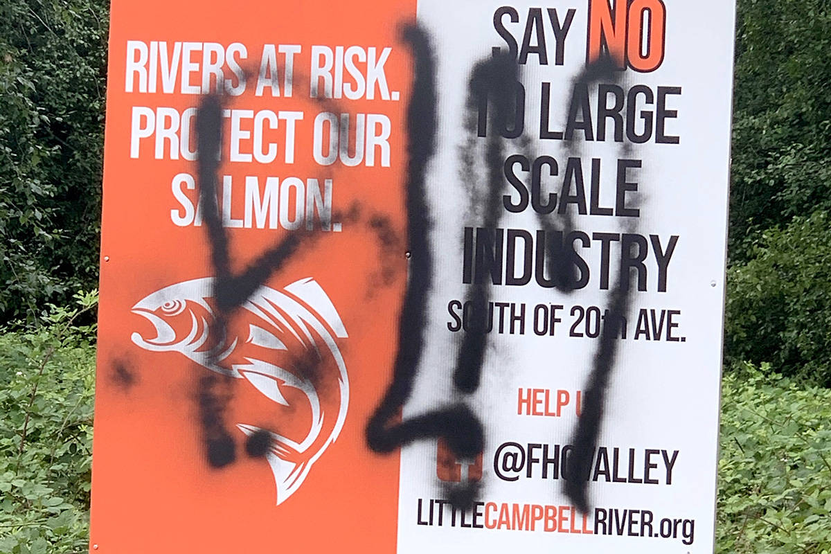 One of two signs erected in support of protecting South Campbell Heights land from large-scale industry was tagged by graffiti, a second was destroyed. (Contributed photo)