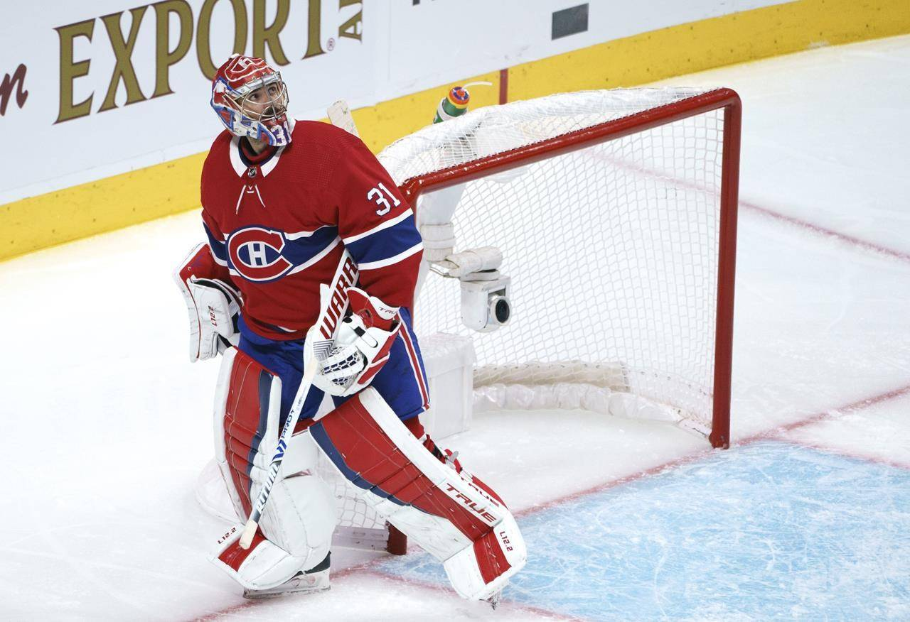 Montreal Canadiens goaltender Carey Price looks up at the replay following a goal by the Vegas Golden Knights during second period of Game 3 of the NHL Stanley Cup semifinal on June 18, 2021 in Montreal. THE CANADIAN PRESS/Paul Chiasson