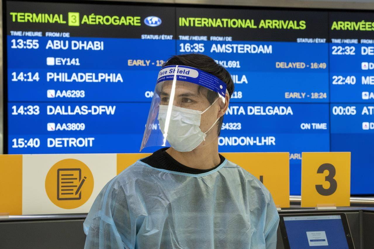 A worker waits for arrivals at the COVID-19 testing centre in Terminal 3 at Pearson Airport in Toronto, Wednesday, Feb. 3, 2021. THE CANADIAN PRESS/Frank Gunn