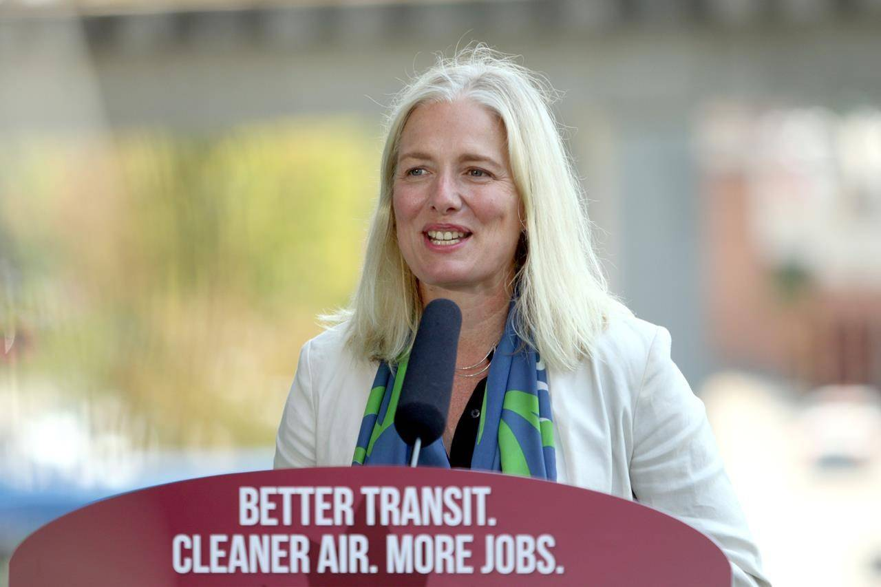 Minister of Infrastructure and Communities Catherine McKenna talks about the recent transit announcement during a press conference at Surrey City Hall in Surrey, B.C., on Friday, July 9, 2021. THE CANADIAN PRESS/Chad Hipolito