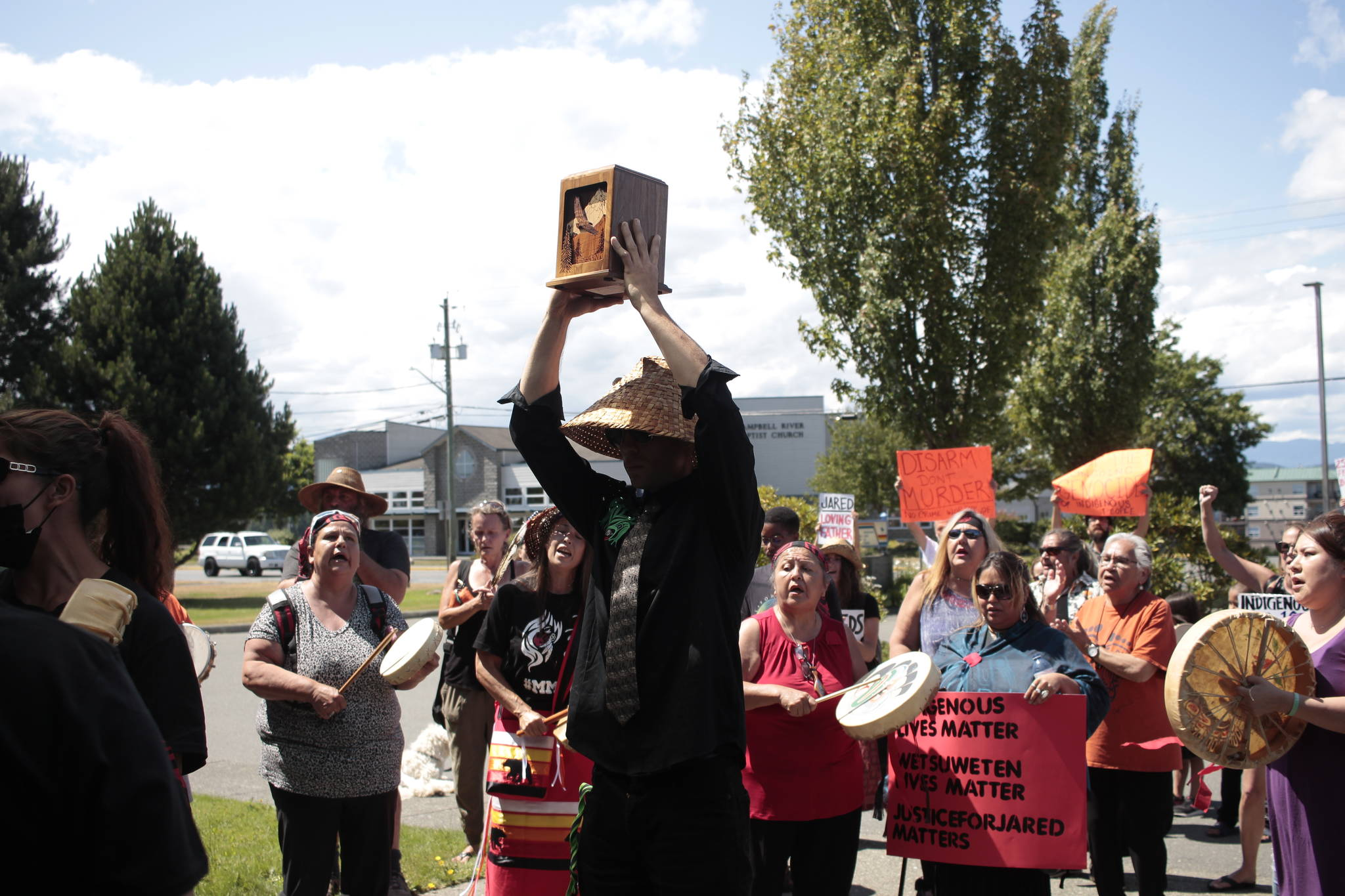 Jared Lowndes' brother Sean Holland holds an urn carrying Lowndes' remains in front of the RCMP station in Campbell River. Photo by Marc Kitteringham / Campbell River Mirror
