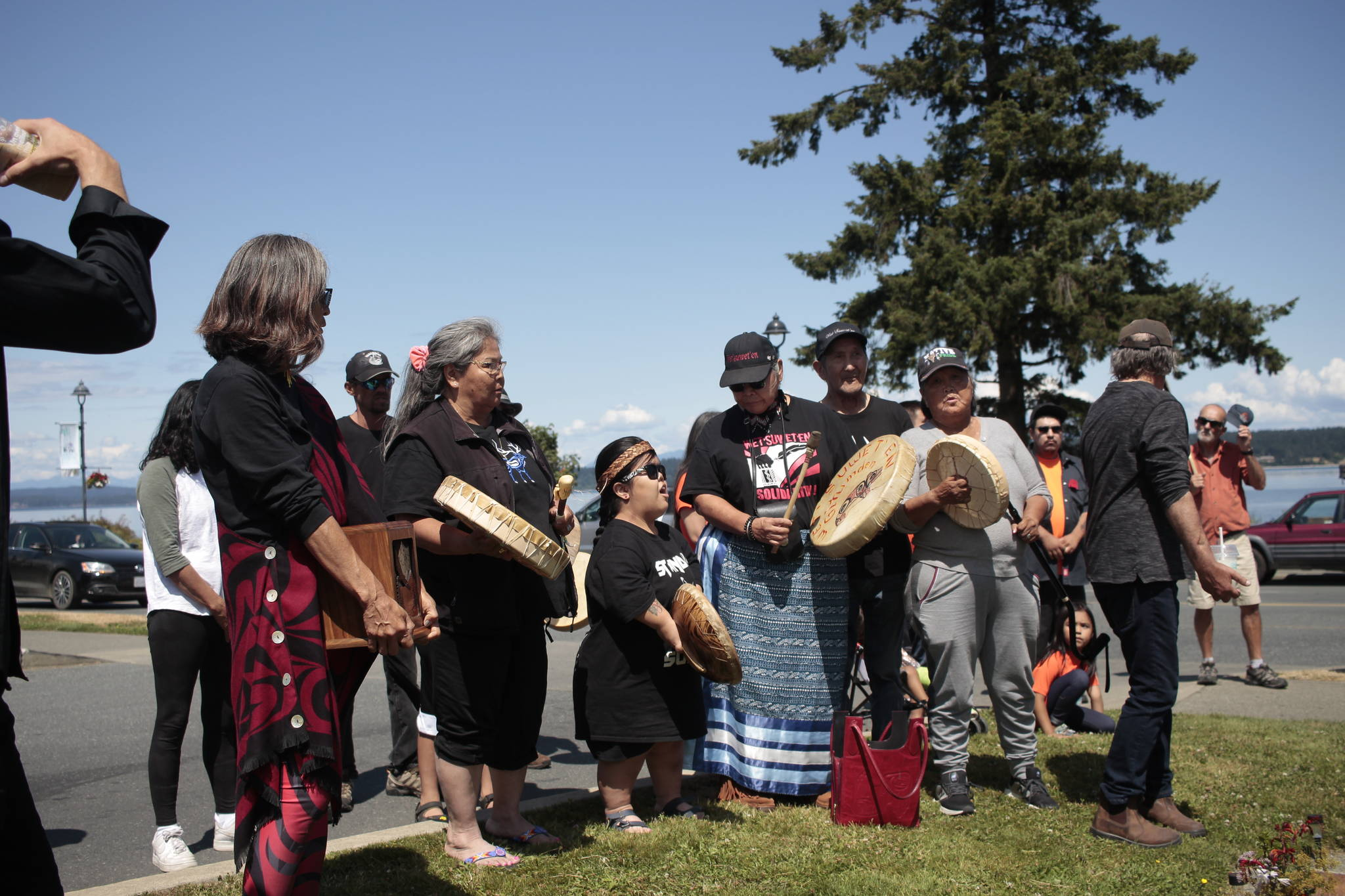 Jared Lowndes' family sings a traditional headdress song in front of the memorial at the Tim Hortons in Willow Point. Photo by Marc Kitteringham / Campbell River Mirror