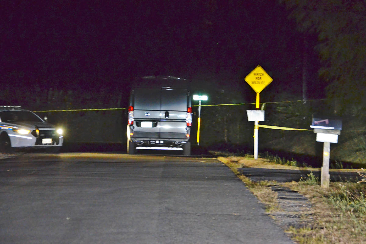 Police have the area of 197th Street and 82nd Avenue cordoned off to investigate a body found in a burned out vehicle. (Heather Colpitts/Langley Advance Times)
