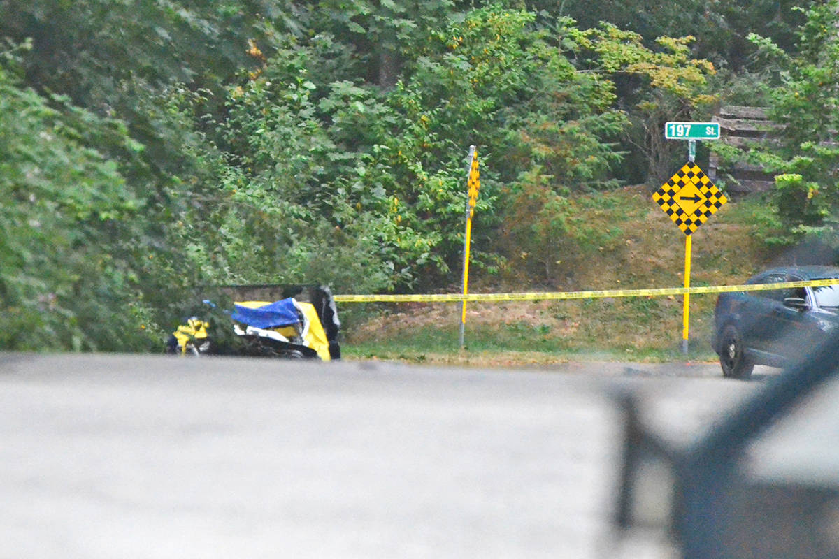 A charred vehicle was at the scene Wednesday morning as investigators continued their work. (Matthew Claxton/Langley Advance Times)