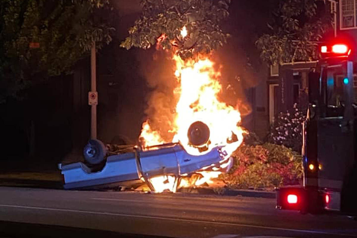 Pickup truck on fire after crashing on 64th Avenue in Surrey on Tuesday evening, July 20. (Submitted photo)