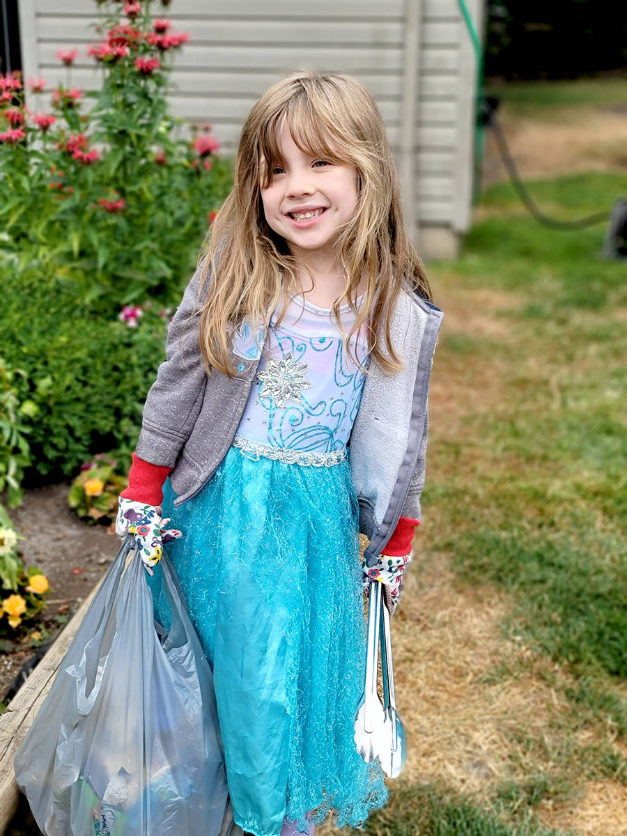 Six-year-old Aldergrove resident Kinsley Moore has taken to cleaning up the streets with BBQ tongs and garbage bags. (Chelsea Moore/Special to The Star)