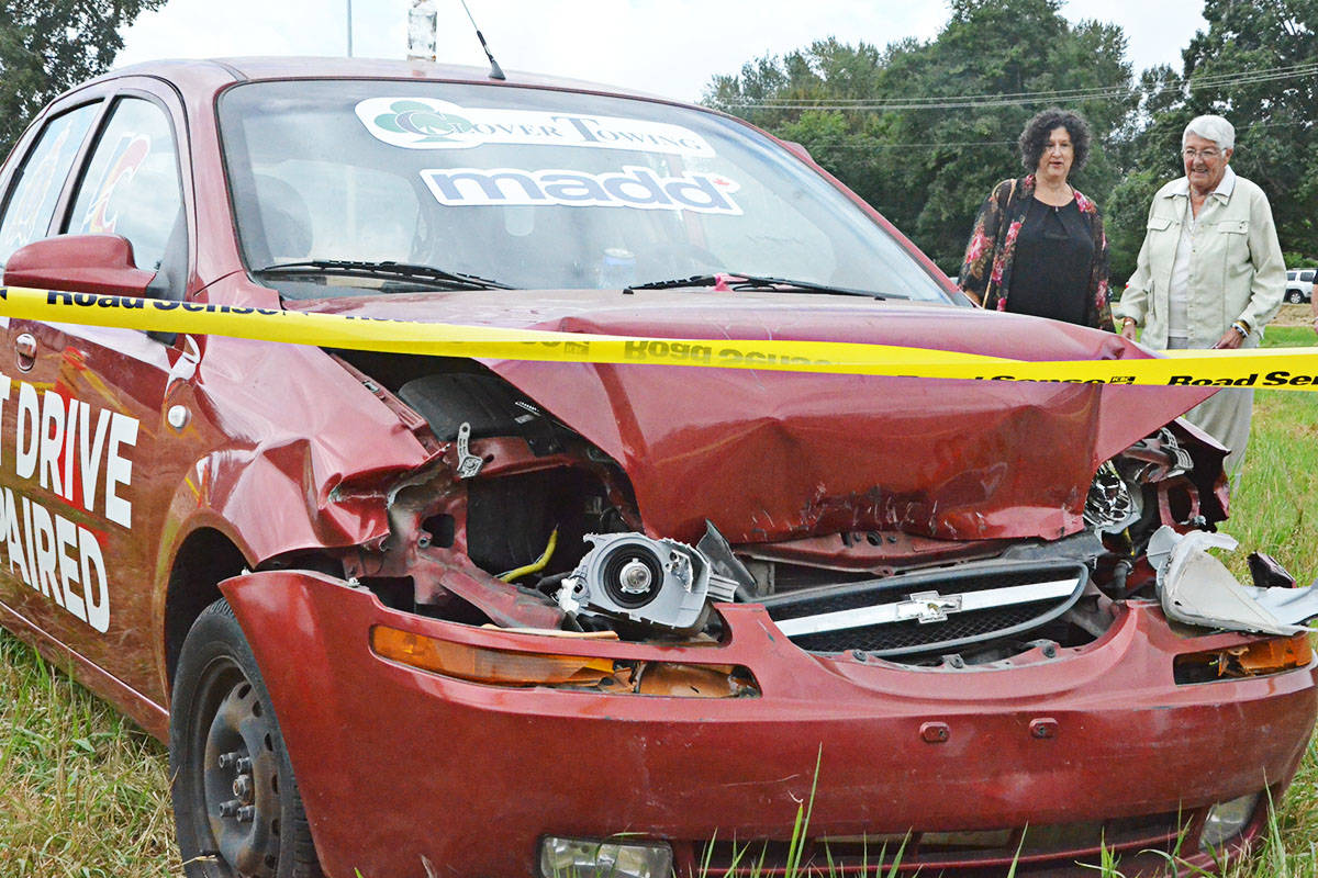 City councillors Rosemary Wallace and Gayle Martin inspected the wrecked car. (Matthew Claxton/Langley Advance Times)
