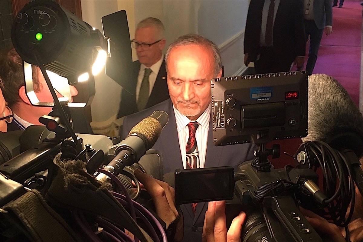 B.C. Labour Minister Harry Bains takes questions from reporters at the B.C. legislature, Nov. 20, 2019. (Tom Fletcher/Black Press)