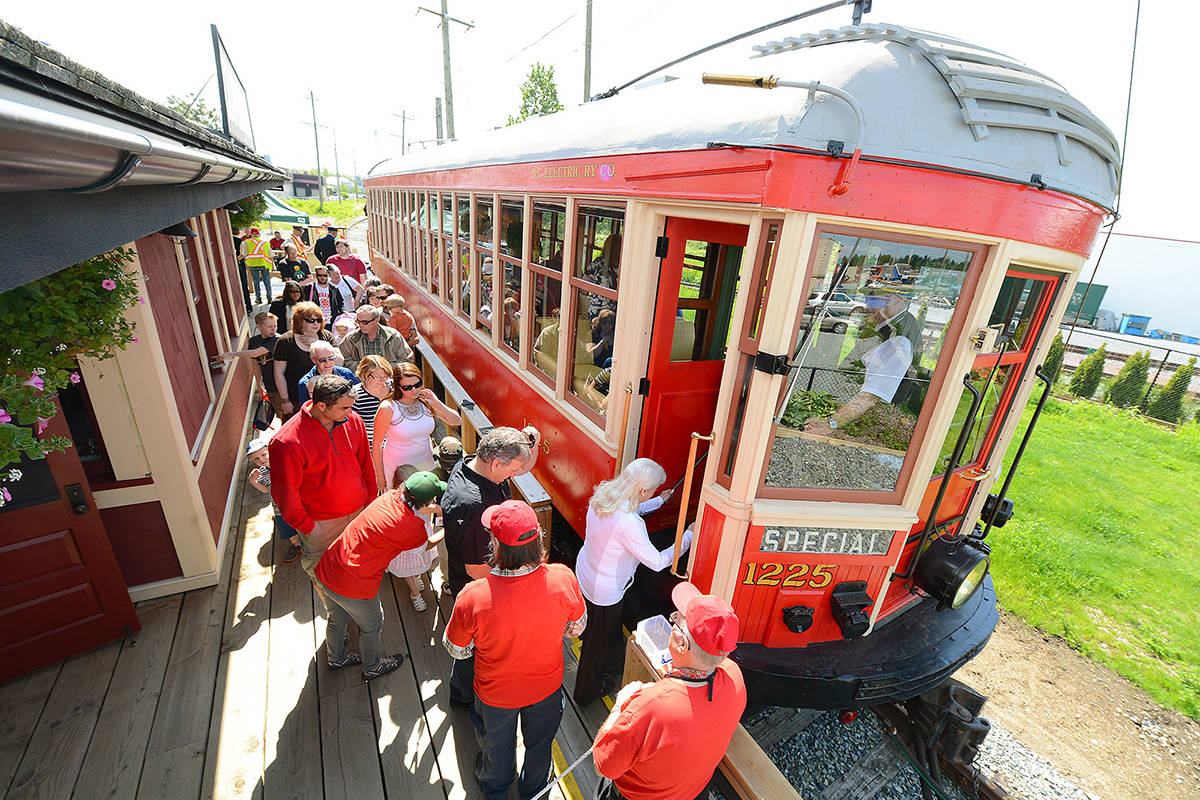 Passengers board the restored B.C. Electric Railway Car 1225 at Cloverdale Station, as part of Surrey's Heritage Rail operations. (File photo)