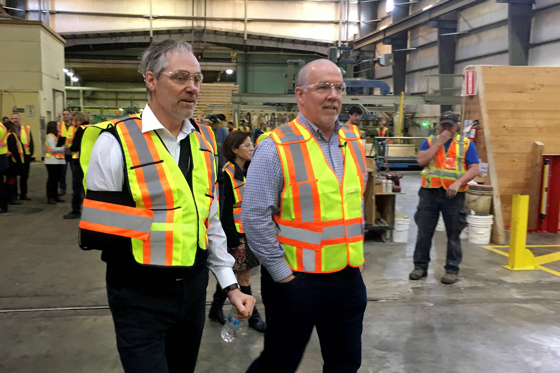 B.C. Premier John Horgan, right, walks with Hardy Wentzel, CEO of Structurlam in Okanagan Falls, March 2019. Horgan's NDP government has emphasized value added production and redistribution of Crown timber licences. (Penticton Western News)