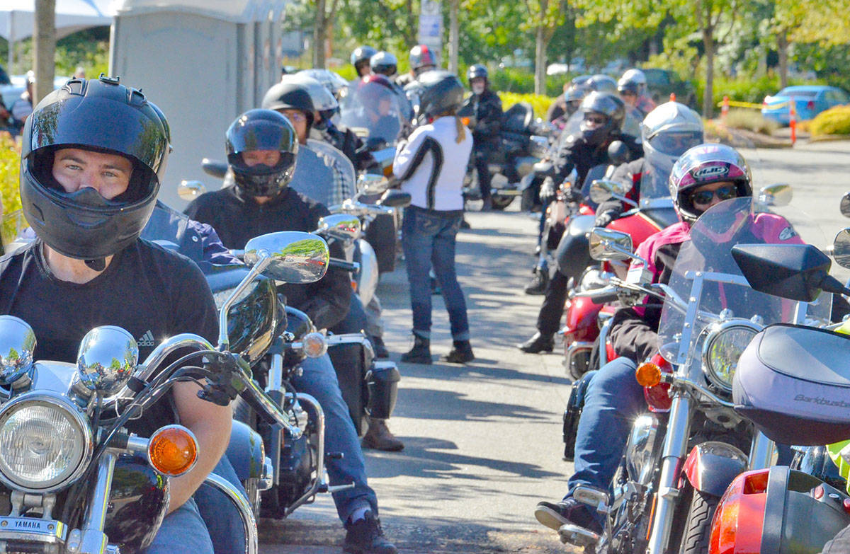 Riders ready to set out on the long distance tour in 2017. (Heather Colpitts/Langley Advance)