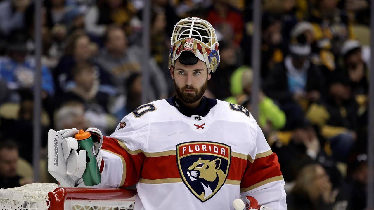 FILE - Florida Panthers goaltender Chris Driedger takes a timeout during the second period of an NHL hockey game against the Pittsburgh Penguins in Pittsburgh, in this Sunday, Jan. 5, 2020, file photo. (AP Photo/Gene J. Puskar, File)