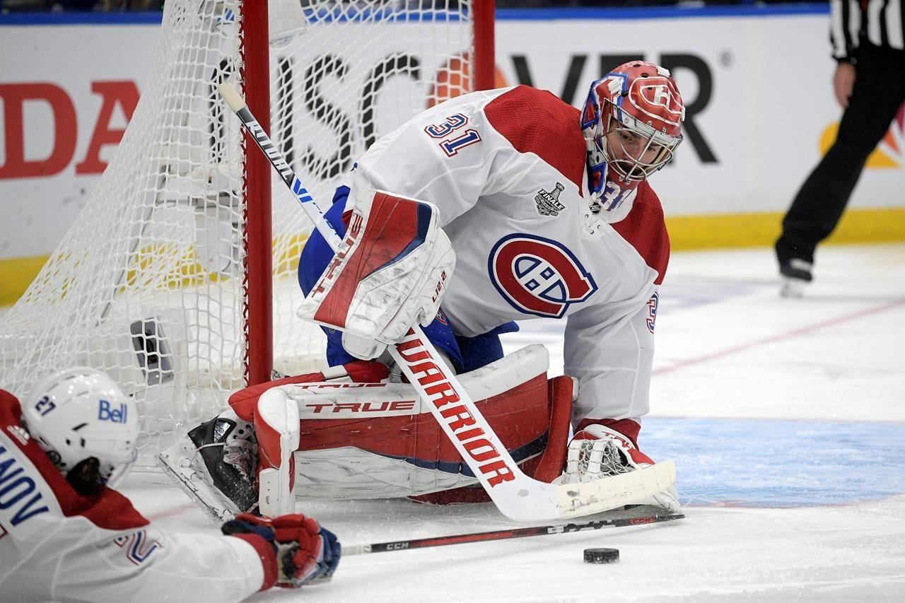 FILE - In this Wednesday, July 7, 2021 file photo, Montreal Canadiens goaltender Carey Price (31) plays the puck during the first period in Game 5 of the NHL hockey Stanley Cup finals against the Tampa Bay Lightning, in Tampa, Fla. (AP Photo/Phelan Ebenhack, File)