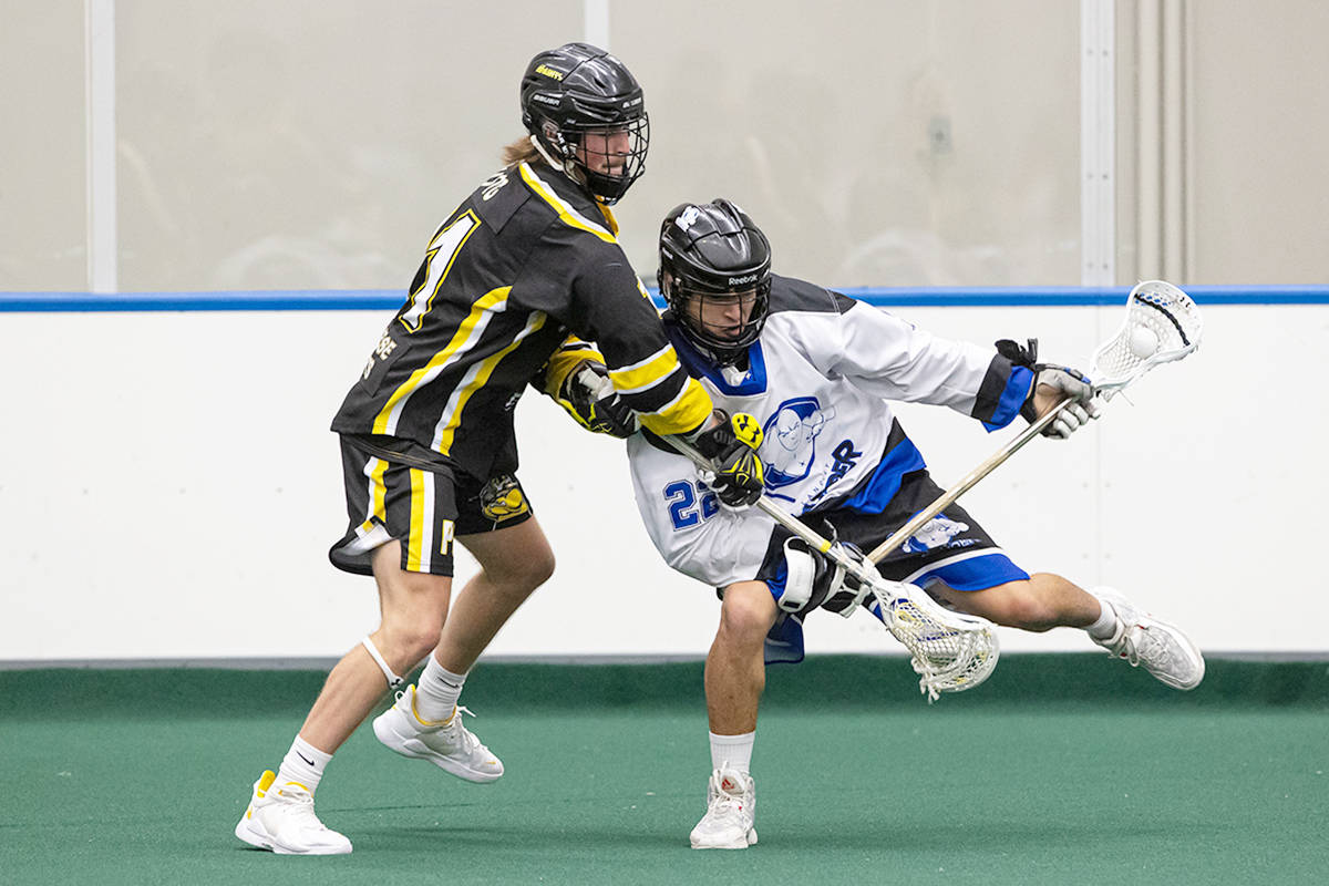Langley Thunder's Trevayne Hunter is closely watched by a Port Coquitlam Saints defender during BCJALL action at Langley Events Centre earlier this month. Hunter had a hand in all five of his team's goals in a 8-5 loss on July 21 in Coquitlam to the host Adanacs. (Damon James Langley Events Centre file photo)