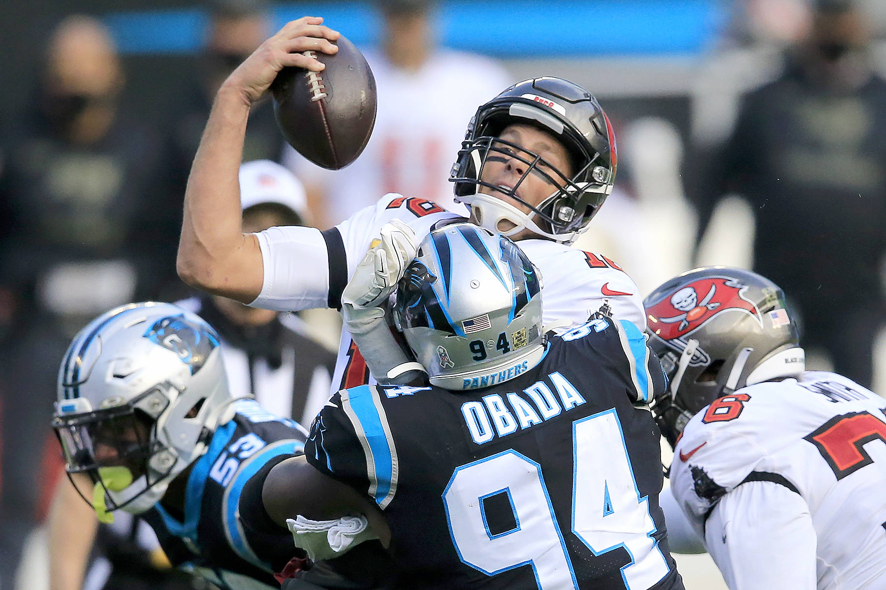 Tampa Bay Buccaneers quarterback Tom Brady (12) is sacked by the Carolina Panthers during the second half of an NFL football game, Sunday, Nov. 15, 2020, in Charlotte , N.C. (AP Photo/Brian Blanco)