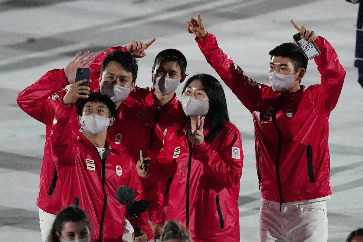 Athletes from Canada walk during the opening ceremony in the Olympic Stadium at the 2020 Summer Olympics, Friday, July 23, 2021, in Tokyo, Japan. (AP Photo/David J. Phillip) Athletes from Canada walk during the opening ceremony in the Olympic Stadium at the 2020 Summer Olympics, Friday, July 23, 2021, in Tokyo, Japan. (AP Photo/David J. Phillip)