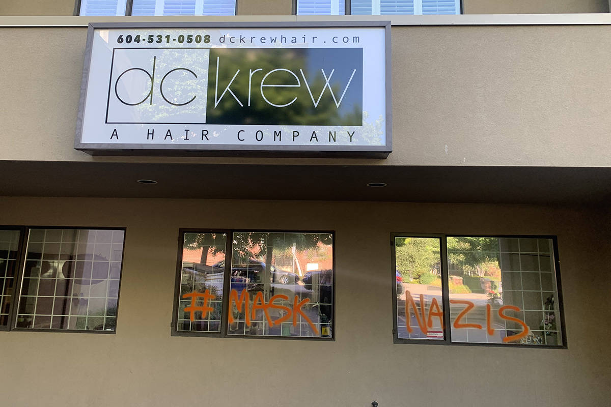 DC Krew Hair Company owners Sandra Davies and Madi Clark say that am anonyous spray painter should have talked to them face to face about their mask policy - instead of defacing the front of their Foster Street business. (Contributed photo)