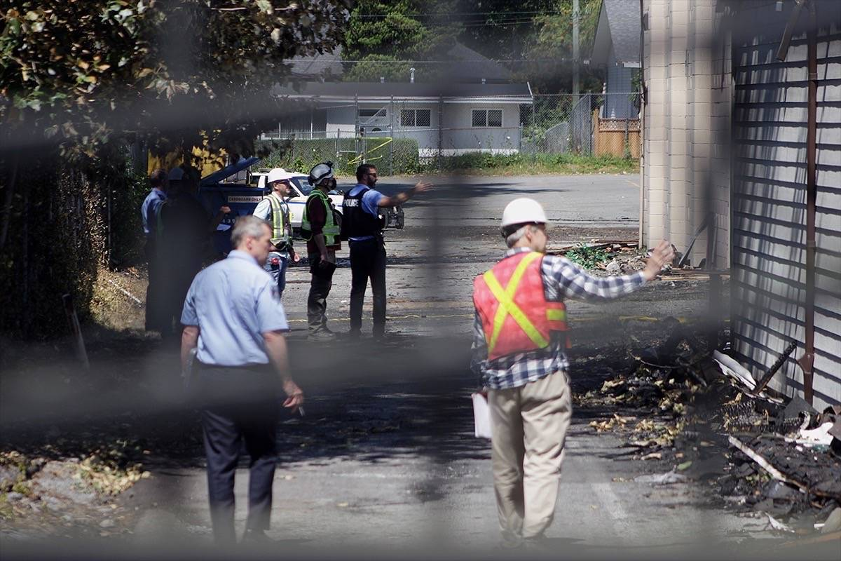 Investigators hunt for evidence in aftermath of July 19 Whalley church fire. (Photo: Lauren Collins)