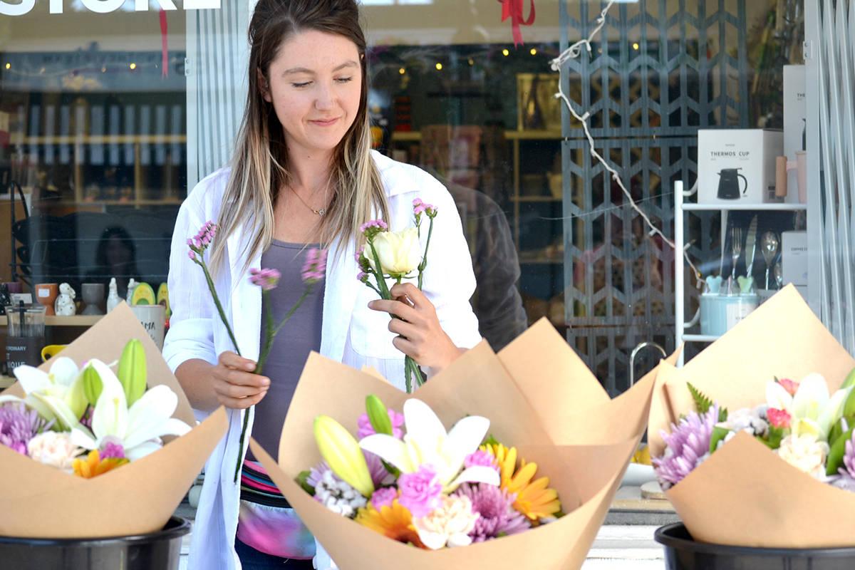 Angelica Arbic is selling flowers in downtown Aldergrove on Fridays and Saturdays all summer. (Ryan Uytdewilligen/Aldergrove Star)