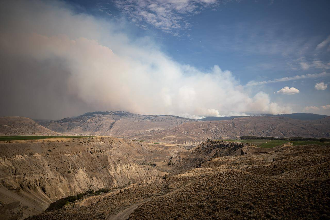 The Tremont Creek wildfire burns on the mountains above Ashcroft, B.C., on Friday, July 16, 2021. THE CANADIAN PRESS/Darryl Dyck