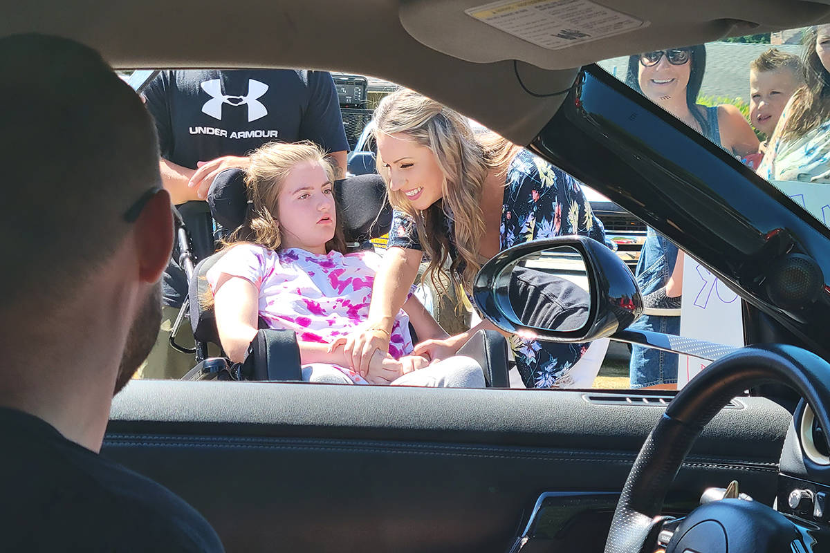 Langley City teen Alyssa Anderson and mom Courtney had a peek inside a supercar on Sunday, July 25, as part of the Drive Project that aims to bring a little motorized magic to special kids. (Dan Ferguson/Langley Advance Times)