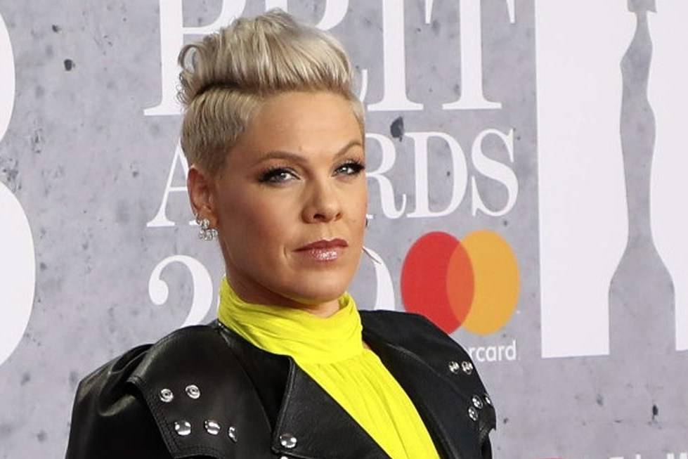 """FILE - In Wednesday, Feb. 20, 2019 file photo, singer Pink poses for photographers upon arrival at the Brit Awards in London. U.S. pop singer Pink has offered to pay a fine given to the Norwegian female beach handball team for wearing shorts instead of the required bikini bottoms. Pink said she was """"very proud"""" of the team for protesting against the rule that prevented them from wearing shorts like their male counterparts. At the European Beach Handball Championships in Bulgaria last week, Norway's female team was fined 1,500 euros ($1,770) for what the European federation called improper clothing and """"a breach of clothing regulations."""" (Photo by Vianney Le Caer/Invision/AP, File)"""