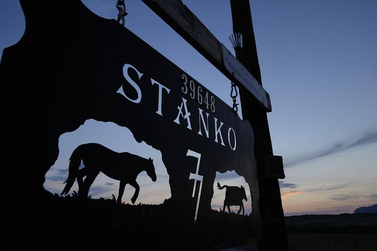 A sign hangs at an entrance to the Stanko Ranch, Tuesday, July 13, 2021, near Steamboat Springs, Colo. Members of the third, fourth and fifth generations of the Stanko family currently work on the ranch, which includes about 90 head of cattle, but Jim Stanko says due to drought conditions this year, if he can't harvest enough hay to feed his cattle, he may need to sell off some of his herd. (AP Photo/Brittany Peterson)
