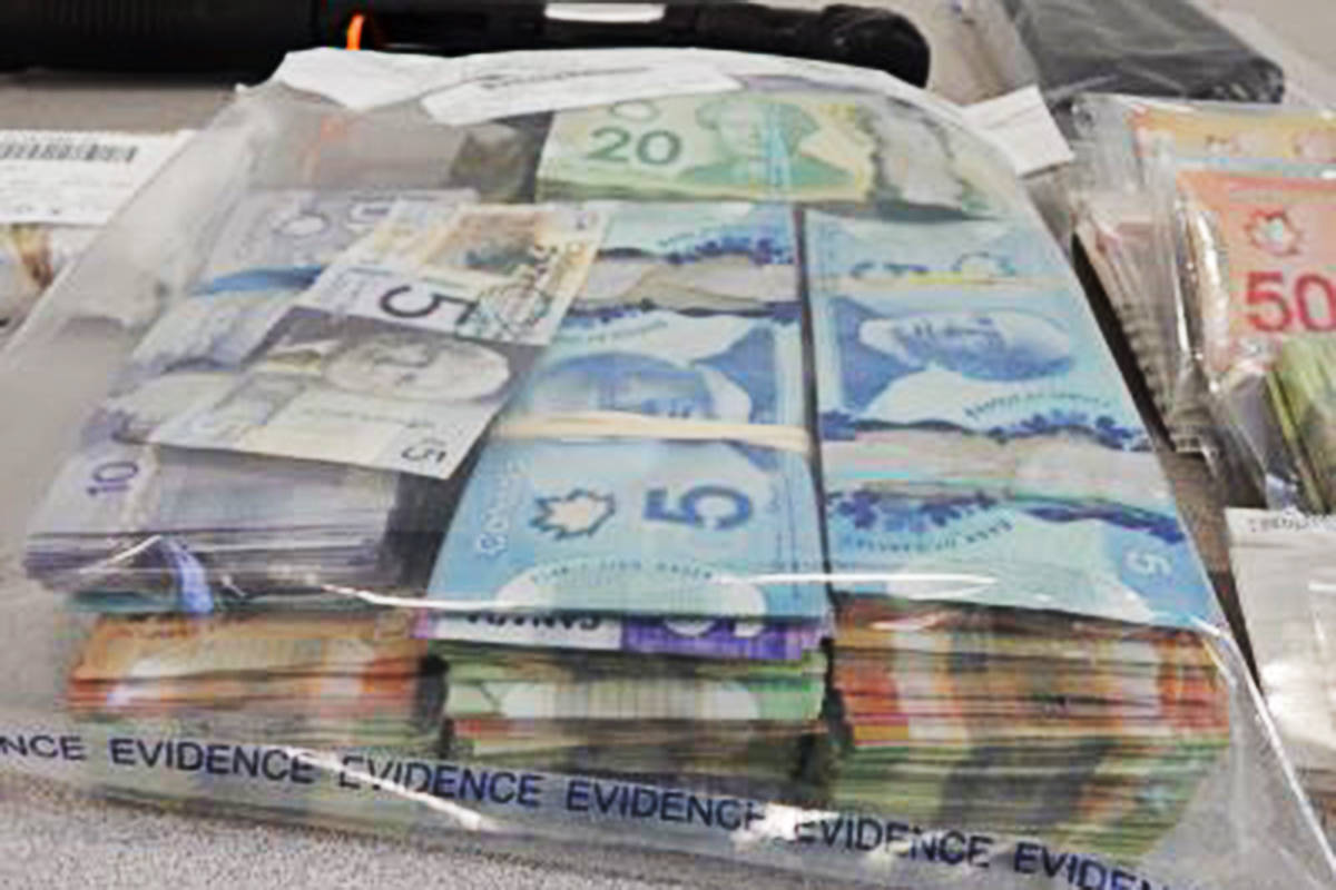 Langley RCMP found drugs, guns, cash, stolen cars, and even a stolen boat when they raided a rural Abbotsford property in June. (Langley RCMP)
