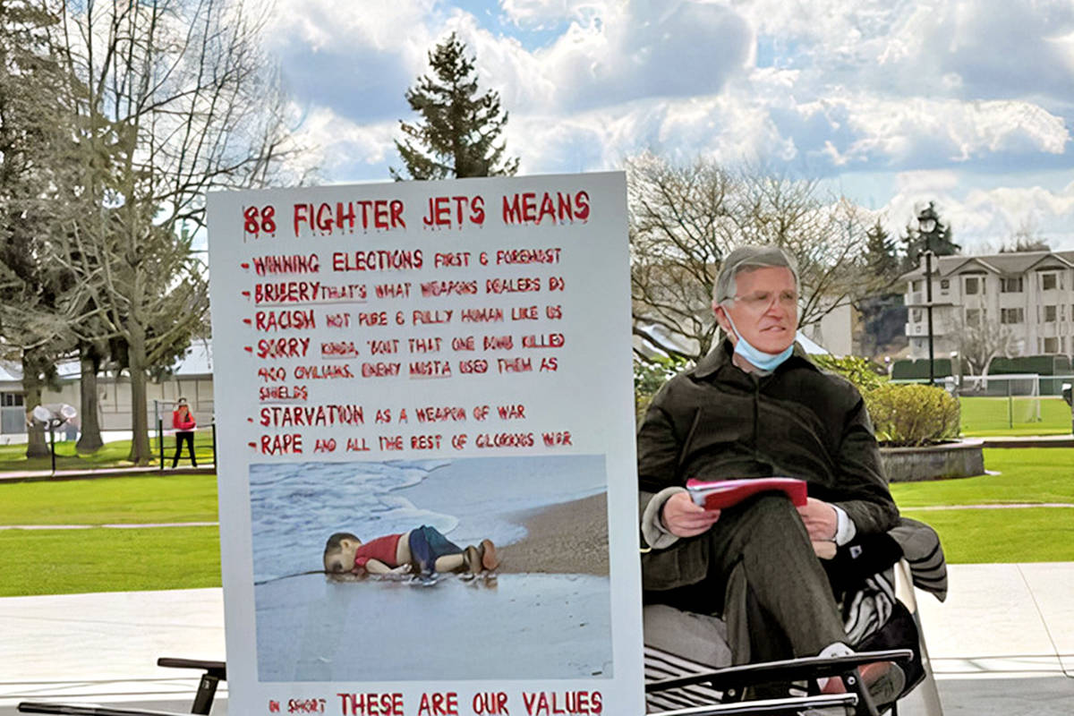 For the first seven days of his protest fast in April 2021, Langley doctor Brendan Martin spent six hours every day in Langley City's Douglas Park with protest signs. He was part of a cross-Canada protest against fighter jet funding. He continues to voice his opposition. (Special to Langley Advance Times)
