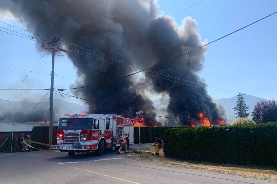 Emergency crews on scene of a barn fire on Castleman Road. (Paul Henderson/ Chilliwack Progress)