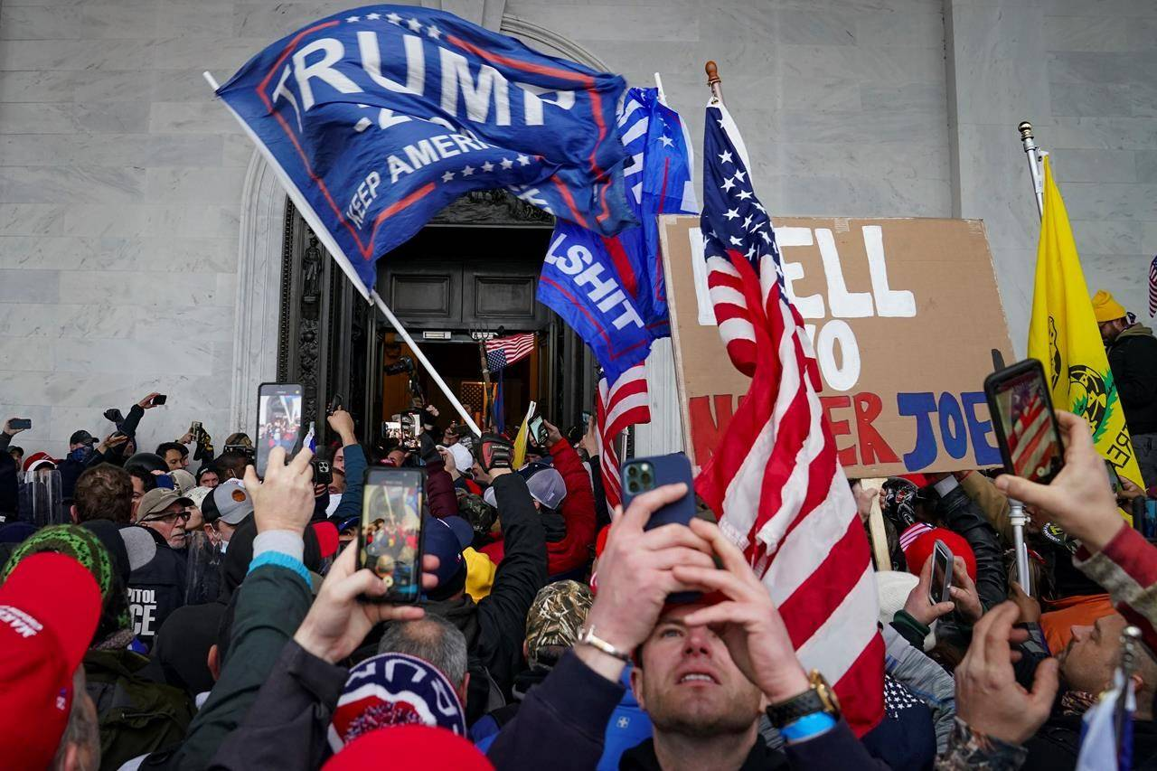 In this Jan. 6, 2021, file photo, Trump supporters gather outside the Capitol in Washington. A group of Capitol Hill and D.C. police officers are on the witness stand as the long-awaited hearings into the Jan. 6 riot get underway. THE CANADIAN PRESS/AP/John Minchillo, File